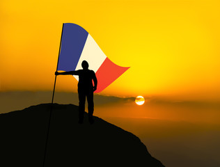 silhouette man winner waving france flag on top of the mountain peak
