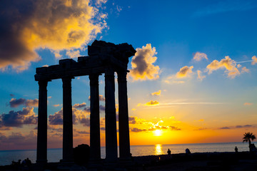 Ruins of an ancient Roman temple during sunset