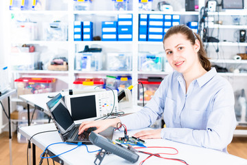 Young woman in electronics repair service center