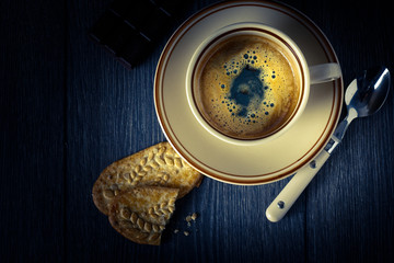 A cup of coffee and biscuits
