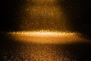Gold glitter vintage lights texture background. defocused