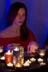red-haired woman wondering on the Tarot cards