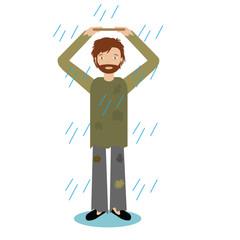 Homeless man standing in rain
