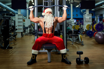 Santa Claus Bodybuilder training at the gym on Christmas Day.