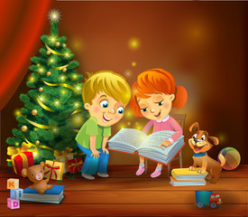 Christmas miracle - kids reading the book beside a Christmas tree