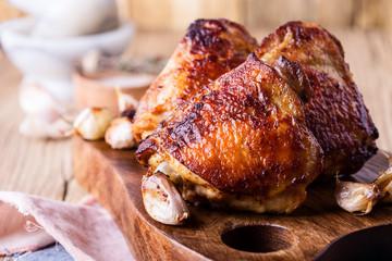 Roast chicken thighs on cutting board