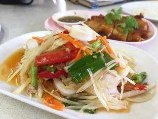 Papaya salad is popular in Thailand.