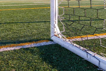 Abstract image of soccer goalpost. Image of corner of goal post. Outdoor sports stadium and field markers.