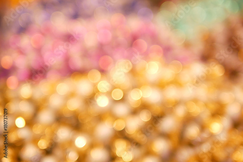 Abstract Blurred Of Gold Pink Green Purple And Yellow