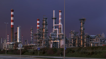 Part of a big oil refinery at dusk