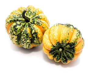 Two whole colorful pumpkin (spotty green yellow) isolated on white background.
