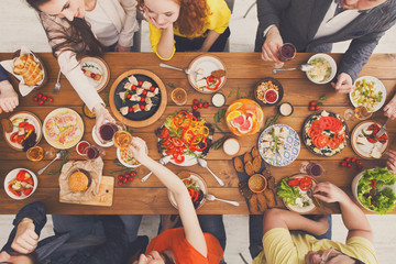 Happy people eat healthy meals at served table dinner party