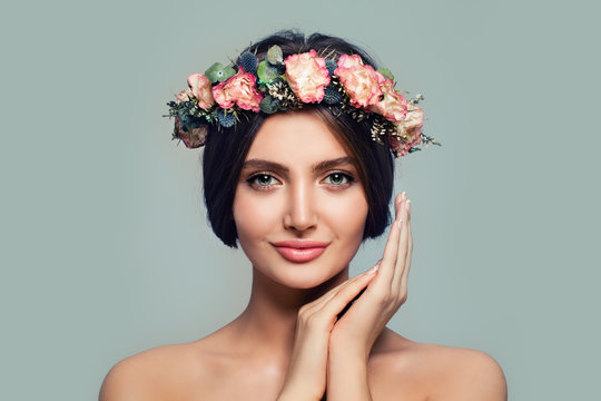 Young Healthy Woman with Flowers. Spa Model on Blue Banner Background. Skincare and Cosmetology Concept