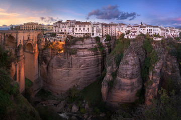 Fotomurales - Panorama of Puente Nuevo Bridge and Ronda Skyline in the Evening, Andalusia, Spain