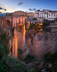 Fotomurales - Puente Nuevo Bridge and Ronda Skyline in the Evening, Andalusia, Spain