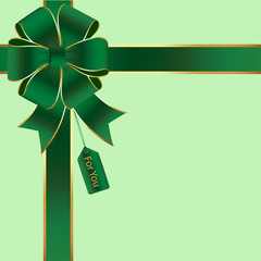 Green and Gold Silk Bow and Ribbon with a Gift Tag