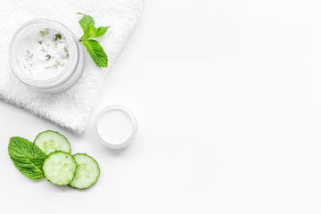 Cucumber moisturising cream or mask. White background top view copyspace