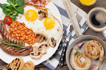 English breakfast. Fried eggs, sausages, bacon