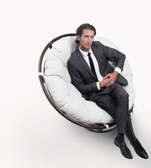 man sitting in the big white chair