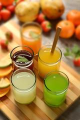 assorted fruit juices with ingredients around