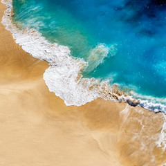 Aerial view to tropical sandy beach and blue ocean