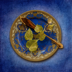 Place setting, plate with leaves and fish knife