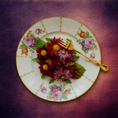 Place setting, plate with flowers and fork