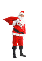 Real Santa Claus carrying big bag full of gifts, isolated on white background
