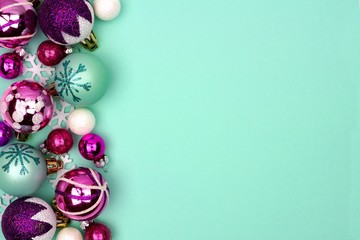 Modern pastel Christmas bauble side border over a turquoise background