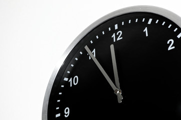 Five To Midnight setting on the black wall clock