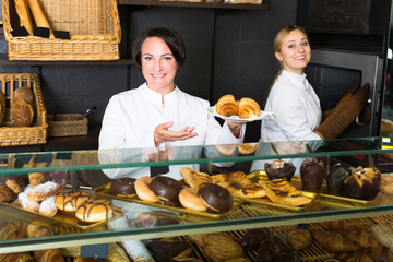 Women with desserts in the pastry shop