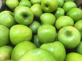 Green apple background in supermarket