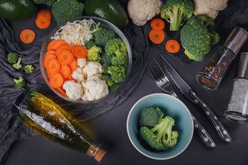Fresh organic vegetables on dark background. Vegetarian food table ingredients.