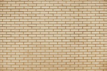 Old beige brick wall background texture
