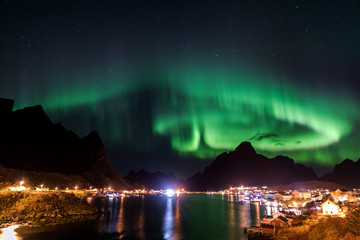 Northern lights over the vilage of Reine