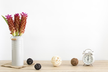 Modern , vintage vase with Siam tulip flower and beautiful pink on wood table and white wall background.