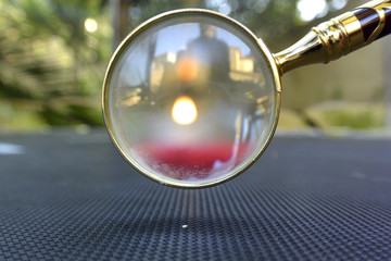 Abstract picture of reflexion and candle flame in a spyglass..