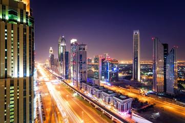 Amazing night dubai downtown skyline and traffic jam during rush hour. Sheikh Zayed road, Dubai, United Arab Emirates