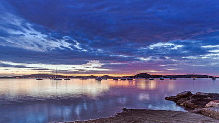Dawn Waterscape with boats on the Bay