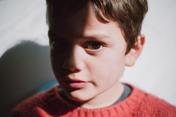 boy indoors in the light