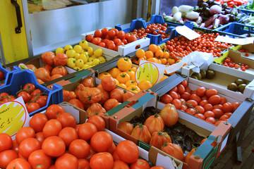 Freshtomatoes on a market stall
