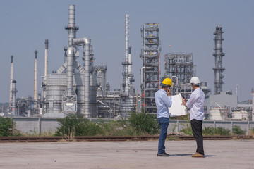 Engineer talking on phone while working in refinary oil