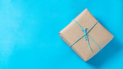 Brown giftbox on blue background