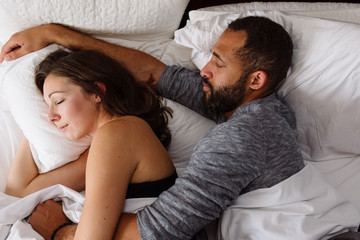 Couple sleeping in bed together