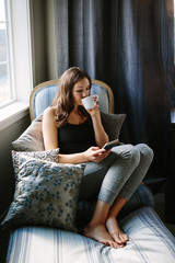 Woman sitting in chair and drinking coffee