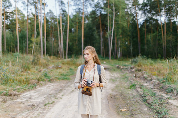 Young girl walking in the forest