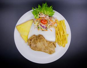Ham steak on a plate