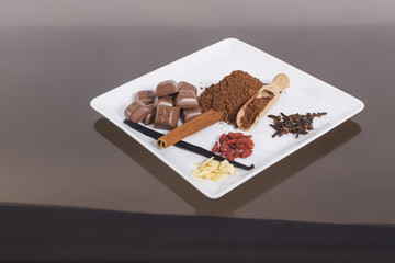 Plate of spiece and chocolate on the glass table