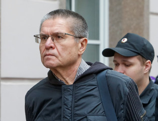 Russian former Economy Minister Alexei Ulyukayev is escorted before a court hearing in Moscow