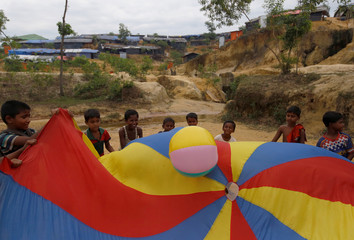 Rohingya refugee children play at the open space near the temporary shelters at Kutupalong refugee camp near Cox's Bazar